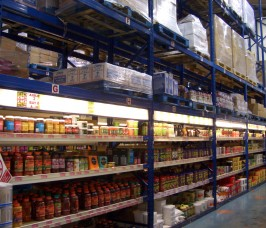 Food Retail warehouse with overhead Pallet Racking storage and lower level shelving