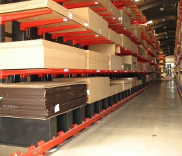 Specialist Trucks operating with Guided Aisle Cantilever Racking for Panel Product Storage