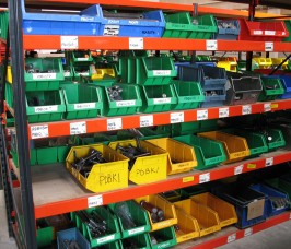 Widespan Shelving Racking with a selection of fixtures and fixings stored in Plastic Bins