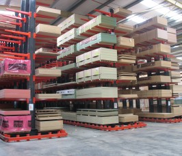 Long loads of Panel Products accessed by specialist trucks with Cantilever Racking Guide Rail system