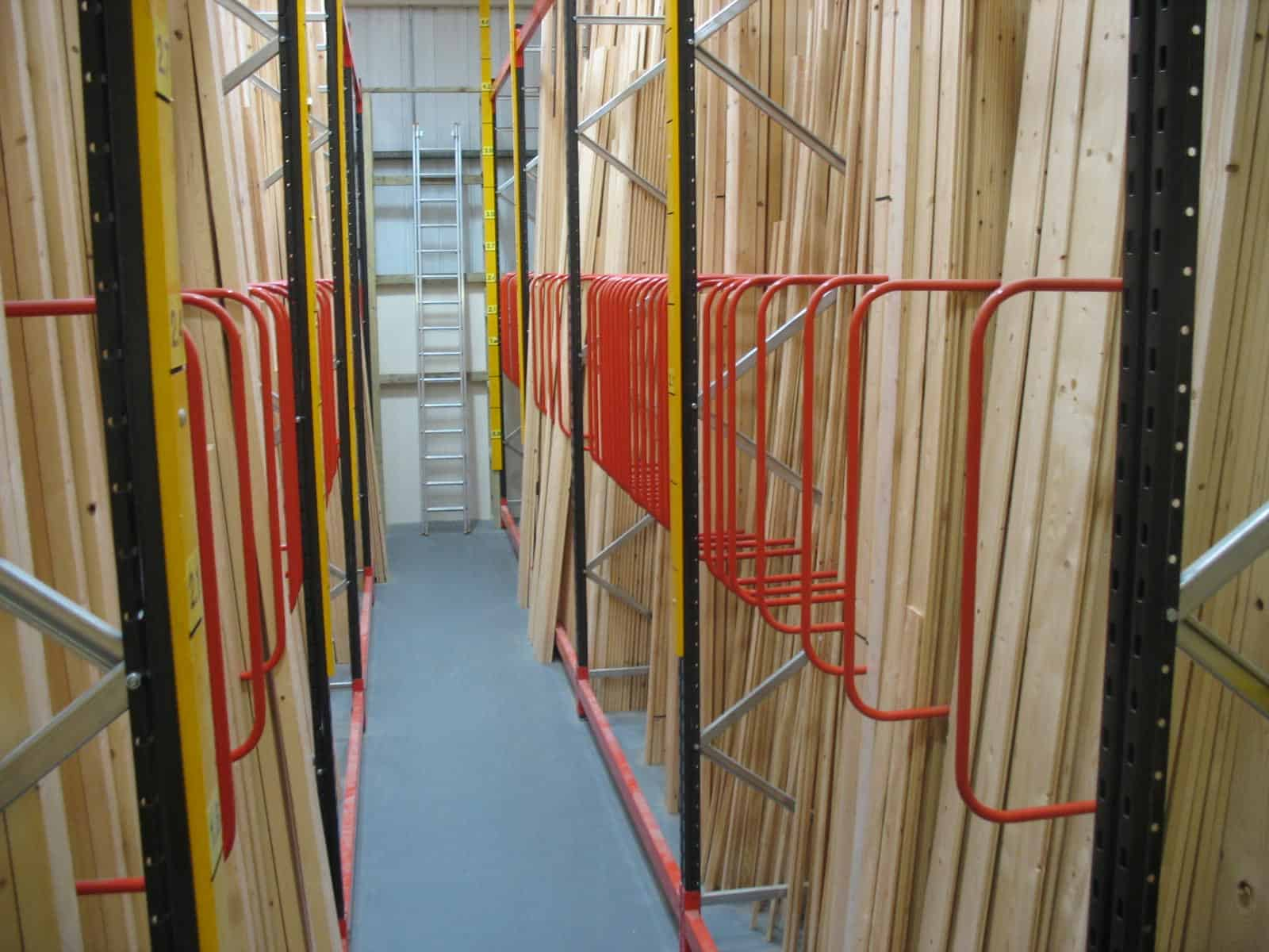 Softwoods stored in Stakapal Integrated Vertical Storage Racking with D - Divider Arms